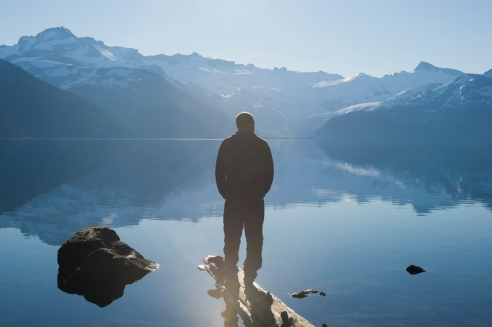 MLF+CO+HOMEPAGE+-+MAN+STANDING+FACING+LAKE+AND+MOUNTAIN